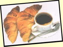 Picture of two croissants and a cup of coffee